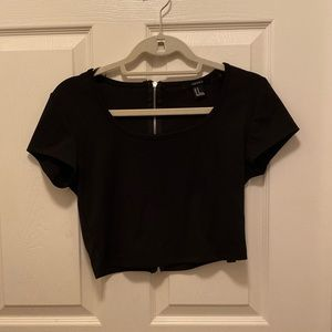 Black crop top with zipper running up the back